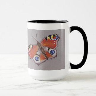 Tasse de papillon de paon
