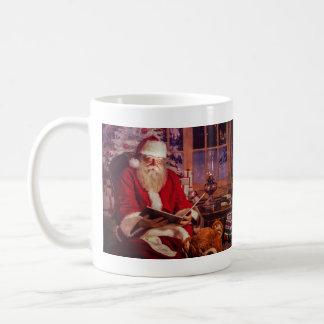 Tasse de Père Noël avec le livre magique