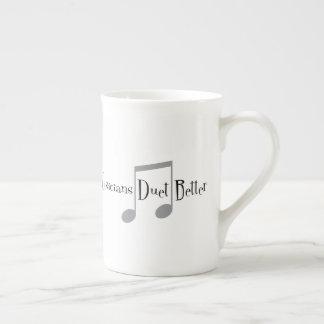 Tasse de porcelaine tendre de duo (notes)