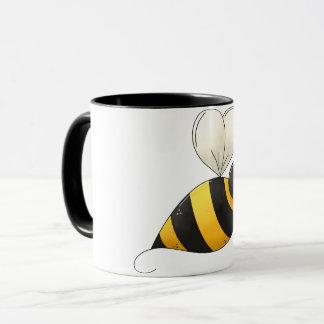 Tasse dodue d'abeille