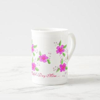 Tasse heureuse de porcelaine tendre de jour de
