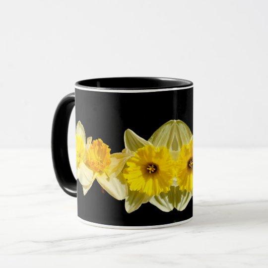 Tasse jaune de jonquille de ressort