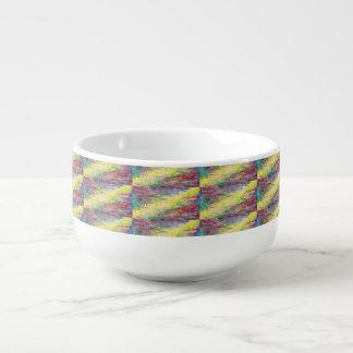 tasse jaune de soupe à rayure