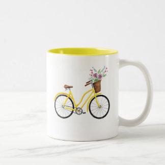 Tasse jaune douce de vélo