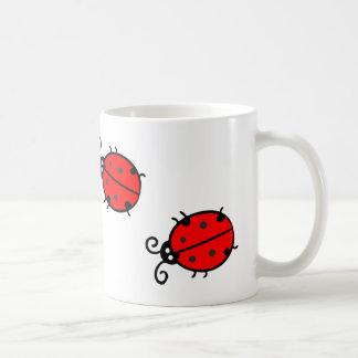 Tasse mignonne de coccinelles