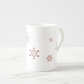 Tasse rouge de café express des flocons de neige |