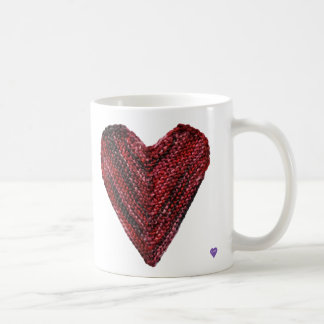 Tasse rouge de coeur de Knit