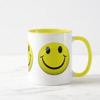 Tasse souriante de visage