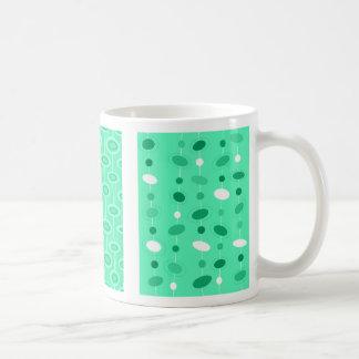 Tasse vert clair de soucoupe
