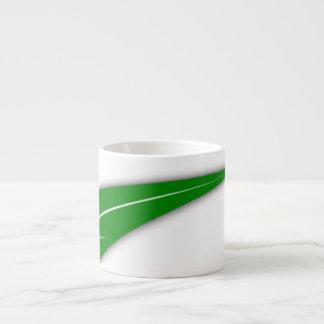 Tasse verte de porcelaine tendre de feuille