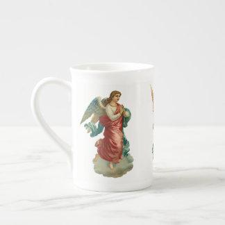 Tasse victorienne de porcelaine tendre d'anges