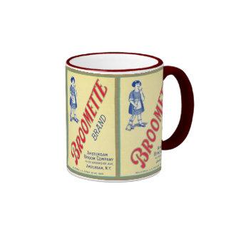 Tasse vintage d'étiquette de la publicité de balai