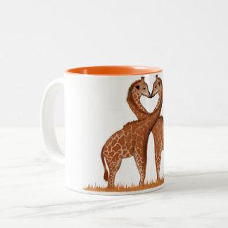 Tasses de coeur d'amour de girafes