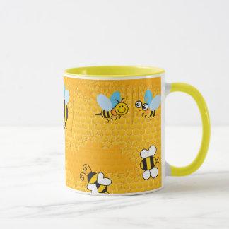 Tasses de sonnerie d'abeille de nid d'abeilles et