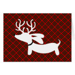 Teckel blanc de renne sur le plaid carte de vœux