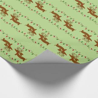 Teckel de renne sur le vert papier cadeau noël