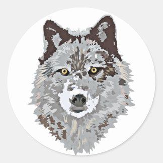Tête stylisée de loup autocollant rond