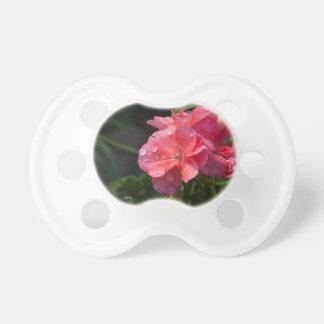Tétine de bébé, fleur rose