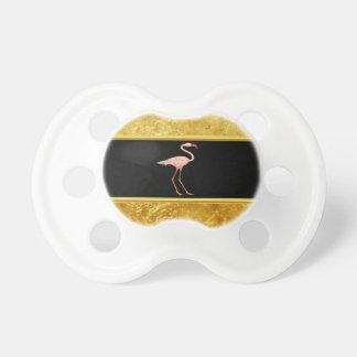 Tétine Flamants roses tenant la texture 1 de feuille d'or