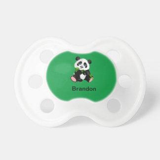Tétine Ours panda noir et blanc mangeant le bambou vert