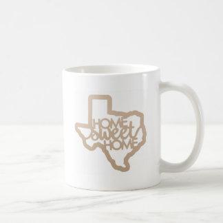 Texan à la maison doux à la maison de tasse du