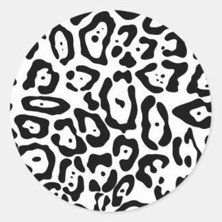 Texture noire et blanche de peau de léopard sticker rond