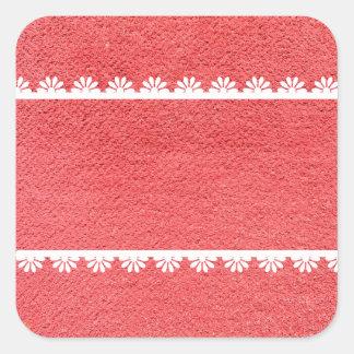 Texture rouge de tissu avec la dentelle blanche sticker carré