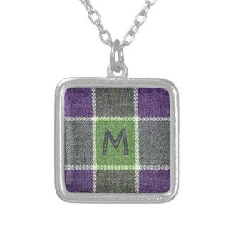 Texture verte et pourpre de flanelle avec le pendentif carré