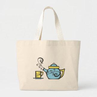 Théière et tasse de remous sac en toile