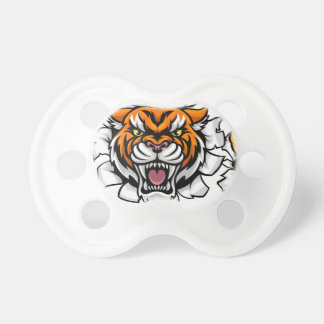 Tigre tenant le ballon de football cassant tétine