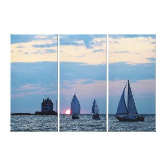 Toile 3 bateaux au coucher du soleil ont enveloppé la