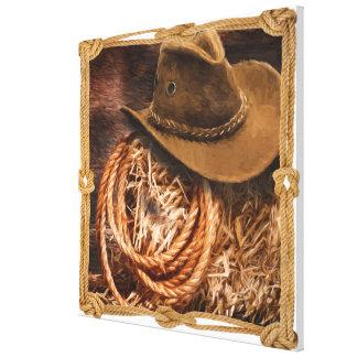 Toile Casquette et lasso de cowboy sur la balle de