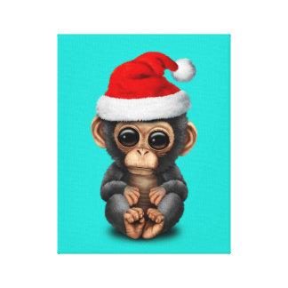 Toile Chimpanzé de bébé utilisant un casquette de Père