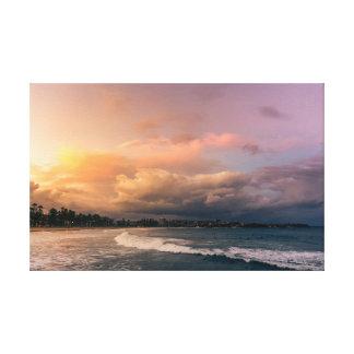Toile Coucher du soleil renversant au-dessus de plage