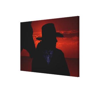 Toile Cowboy et cheval de silhouette