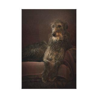 Toile Deerhound on a sofa