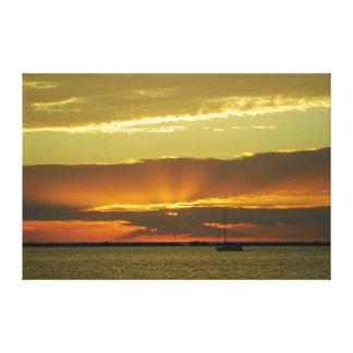 Toile La navigation dans le coucher du soleil a