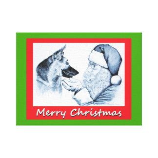 Toile Le père noël et berger allemand pour Noël