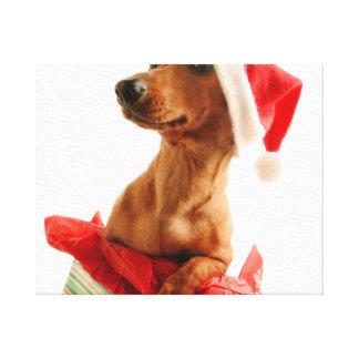 Toile Le teckel père Noël - le chien de père Noël -