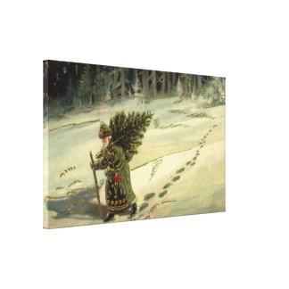 Toile Noël vintage, le père noël portant un arbre
