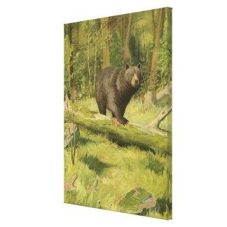 Toile Ours noir faisant un pas sur un tronc d'arbre