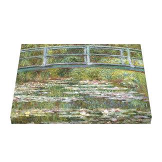 Toile Pont au-dessus d'un étang des nénuphars par Claude