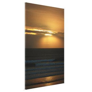 Toile Surfer au coucher du soleil