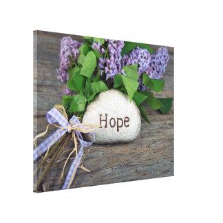 Toile Texte d'espoir sur la roche avec des lilas