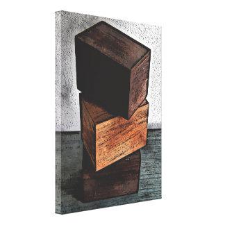 Toile Trois boîtes en bois sur la raboteuse