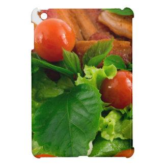 Tomates cerise, herbes, huile d'olive, oeufs et coques pour iPad mini