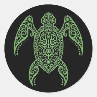 Tortue de mer noire et verte complexe adhésif rond