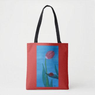 Tote Bag Coccinelle sur une feuille avec une tulipe