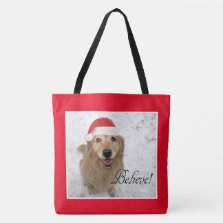 Tote Bag Le chien de golden retriever croient Noël