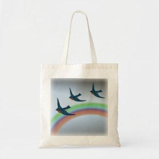 Tote Bag Troupeau des oiseaux bleus volant au-dessus d'un